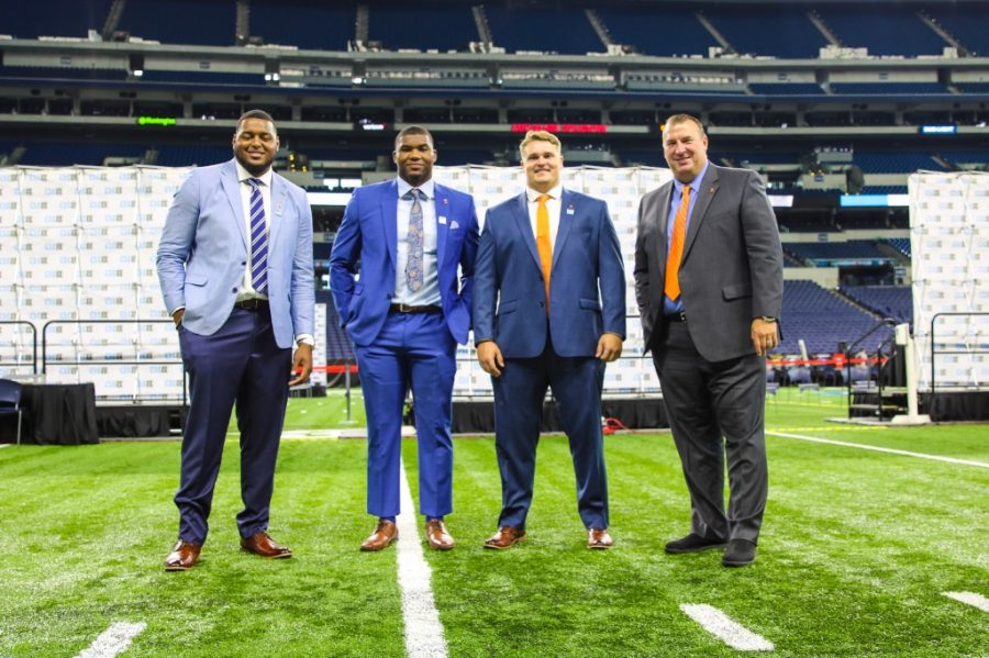 Vederian Lowe, Owen Carney, Doug Kramer and Bret Bielema pose for a photo at Big Ten Media  Days in Indianapolis. The idea of family has become a recruiting tactic for Bielema and his staff, with all three players choosing to return after hearing their pitch.
