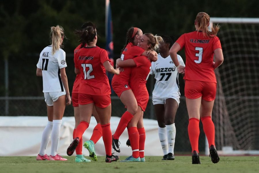 Members of the Illinois soccer team embrace during the game against Mizzou Aug. 19 where they won 4-0. The Illini hope to continue their momentum against Illinois State University on Sunday