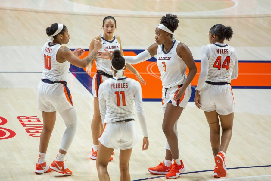 Players of the Illinois womens basketball team come together during a pause in the game against Valparaiso Dec. 2. Illinois will host Florida State in the 2021 Big Ten/Atlantic Coast Conference Womens Basketball Challenge.