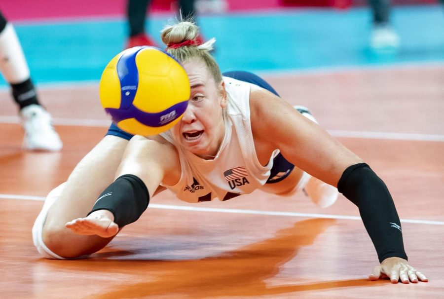 Former Illini Michelle Bartsch-Hackley dives to save the ball July 27 during the Tokyo Olympics. All eight former Illini at the Olympics have been working hard.