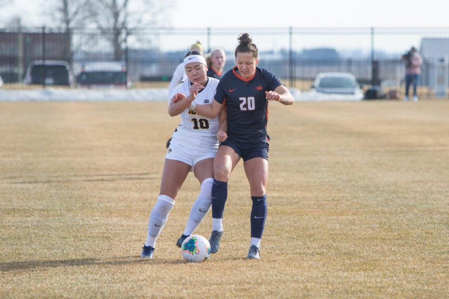 Graduate Makena Silber fights over the possession of the soccer ball against Iowa Feb. 25. With the new season coming in soon, break downs of the games are shown.