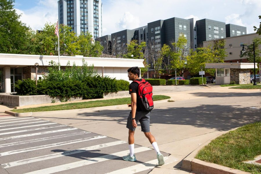 A student walks across the intersection of Green and Second Street on Wednesday afternoon where a shooting took place only a few days ago. University students are concerned for their safety.