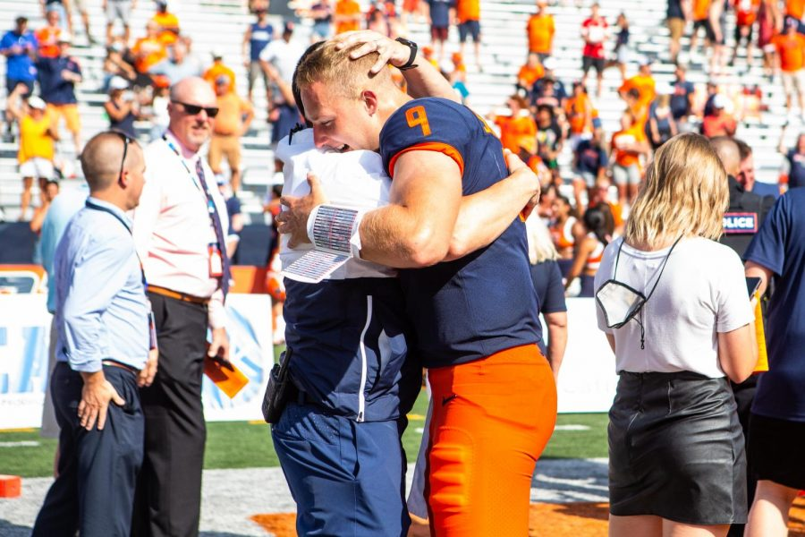 Illinois quarterback Artur Sitkowski celebrates after the game against Nebraska at Memorial Stadium on Saturday. Sitkowski was not expected to play, though he got significant game time during the final three quarters following an upper-body injury to Brandon Peters.