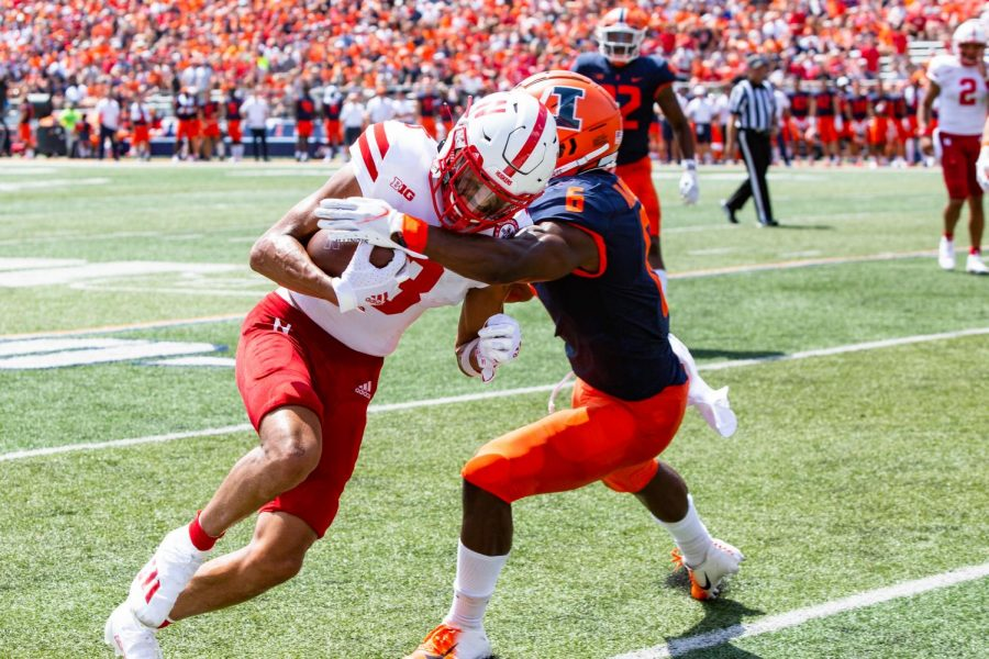 Senior defensive back Tony Adams holds back Nebraska wide receiver Samori Toure during the game at Memorial Stadium Saturday afternoon. The Illini came out on top with a 30-22 win against Nebraska.