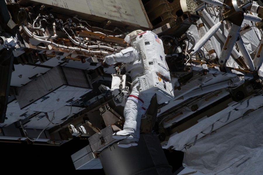 NASA spacewalker, Expedition 64 Flight Engineer, and Illinois alumni Michael Hopkins works to ready the International Space station's port-side truss structure for future solar array upgrades on Jan. 27. Hopkins reflects on his most recent experience leaving for space in the midst of a pandemic.