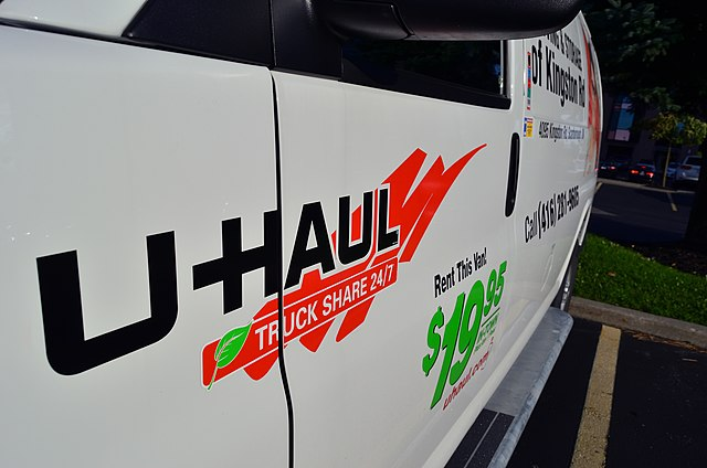 A U-Haul truck sits in a parking lot. The U-Haul company has caused Illinois students much stress after canceling rentals.