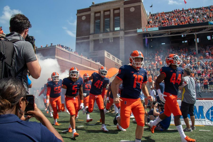 The Illinois football team runs out onto the field for the first quarter against Nebraska on Aug. 28.
