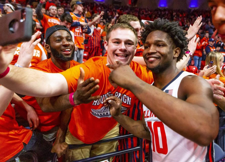 Illinois guard Andre Feliz takes a photo with Journalism student Noah Nelson during March 8, 2020. Columnist Noah Nelson owes much of his love for Illinois basketball to former guard Ayo Dosunmu who was recently drafted by the Chicago Bulls.