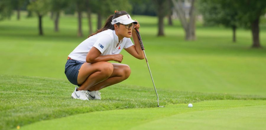 Senior Crystal Wang lines up where she needs to putt the ball. Senior Crystal Wang hopes to step-up her game with the upcoming season.