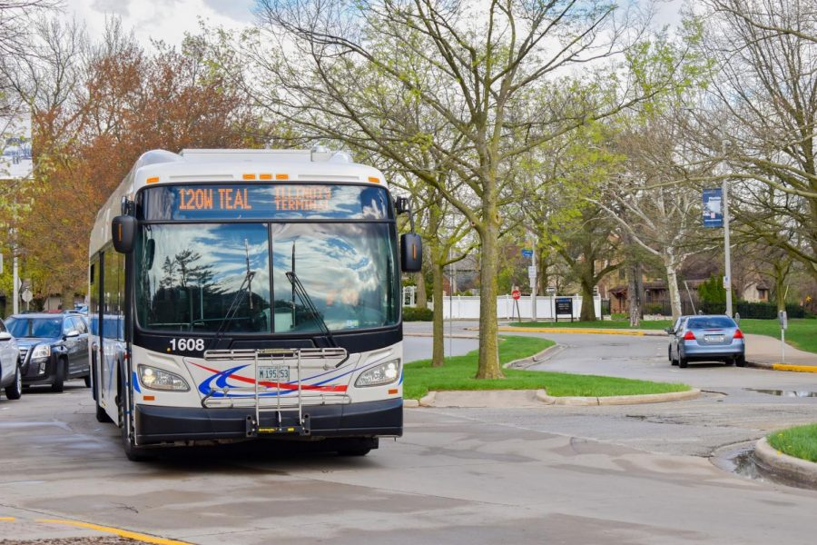 The MTD bus drives around on campus. MTD is resuming fares during Covid-19.