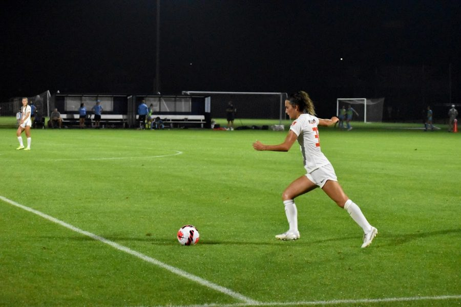 Junior Ashley Cathro kicks the ball against the University of North Carolina on Aug. 26. The team has much motivation for their upcoming game against Butler on Aug. 29.