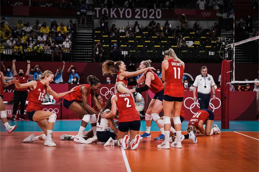 The USA Women's Volleyball Team celebrates a victory against the Brazil team. The USA Women's Volleyball Team won gold on Aug. 8.