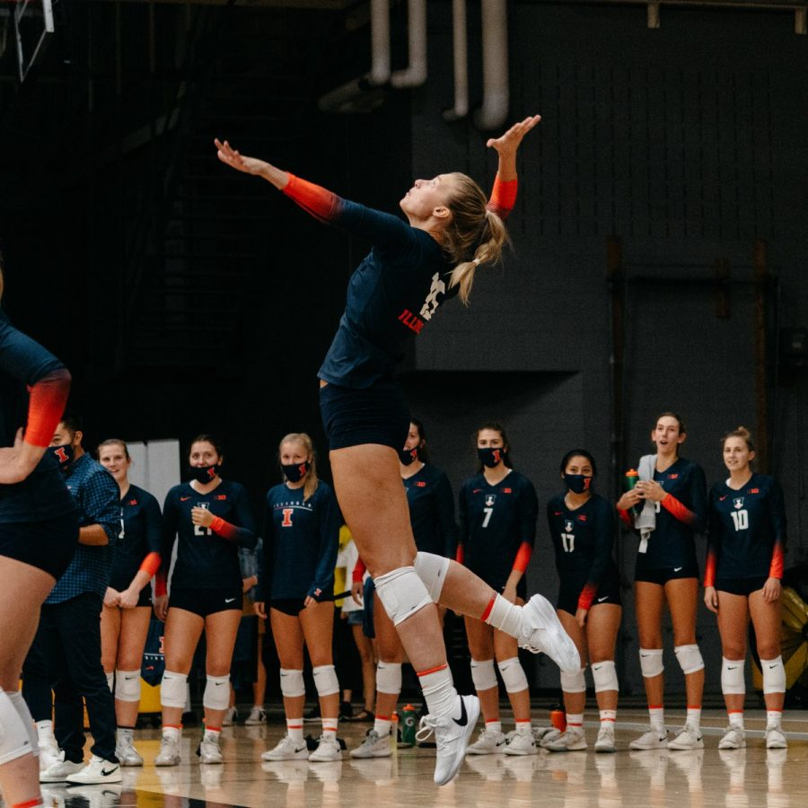 Graduate Student Megan Cooney sets the ball during their volleyball game against Valparaiso Aug. 28. Megan Cooney had 13 kills during their game as they ride the high back to Champaign.