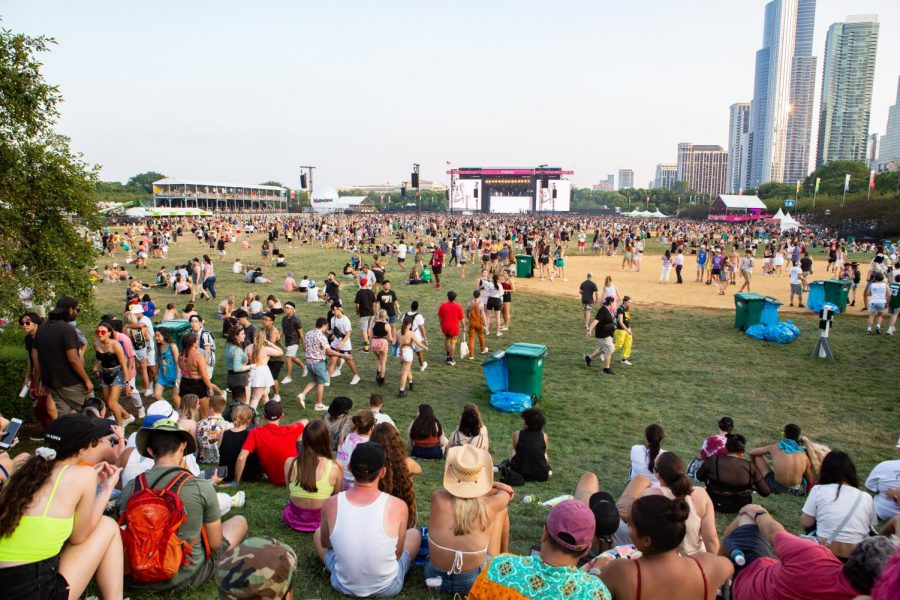 Festival goers at Lollapalooza walk between the T-Mobile and Lake Shore stages in Grant Park on Thursday. The Chicago festival took place during a surge in Covid-19 cases.