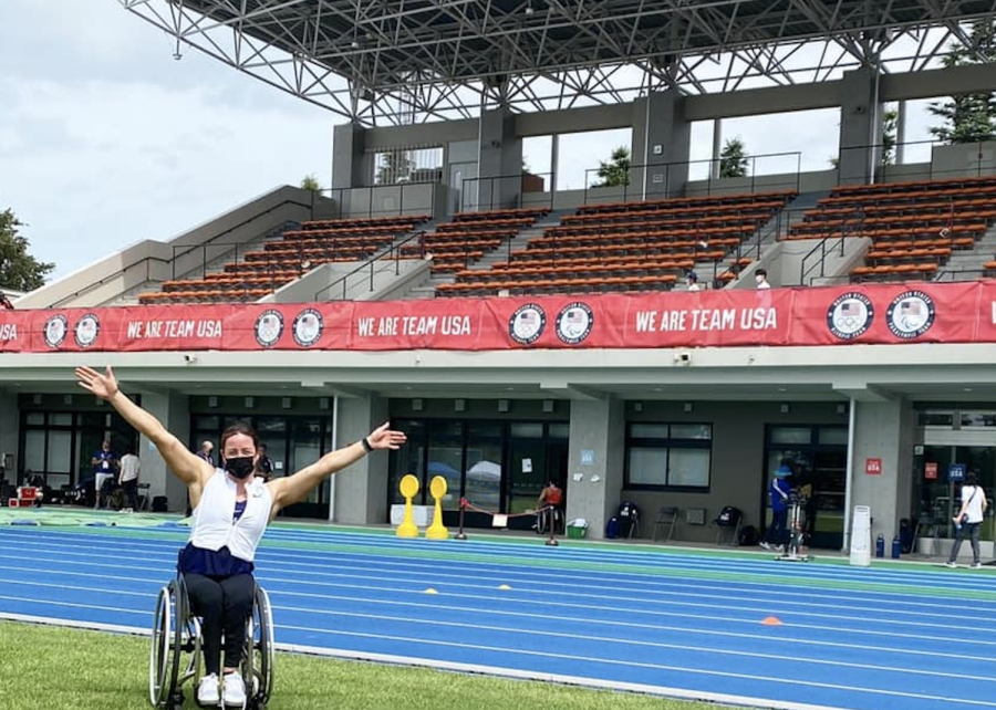 USA Paralympic athlete Tatyana McFadden poses for a photo in front of the track she will be competing on in the coming days. McFadden is an Illinois alumni and is set to make a big impact in wheelchair racing as she has accumulated 17 medals over the course of three olympic games.