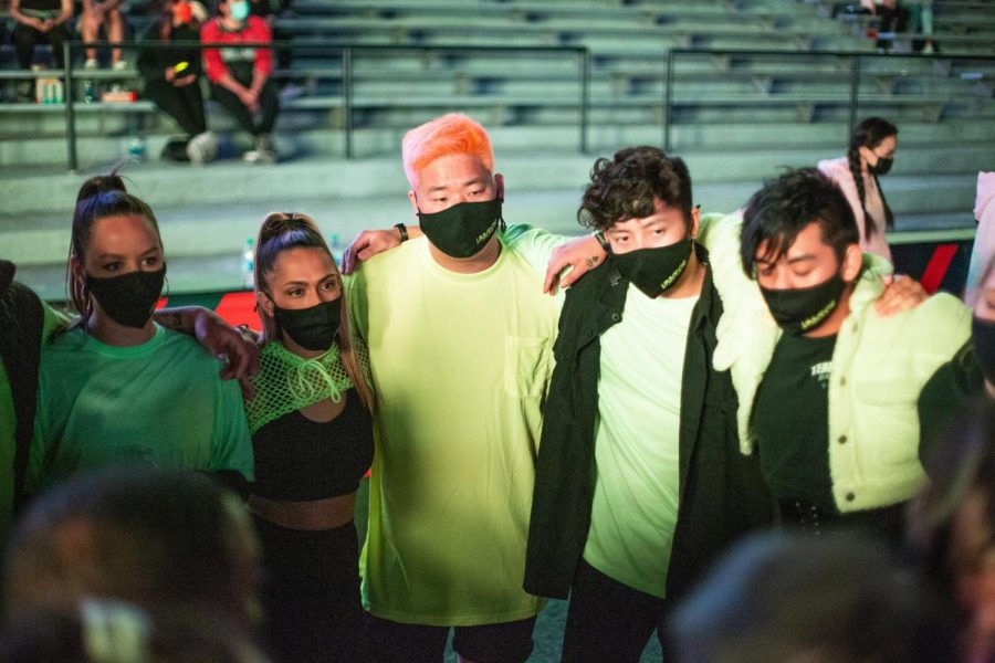 Students stand in a circle masked during Urbanite on May 1.  The University of Illinois is now requiring students to wear masks in public spaces to stop the spread of Covid-19.