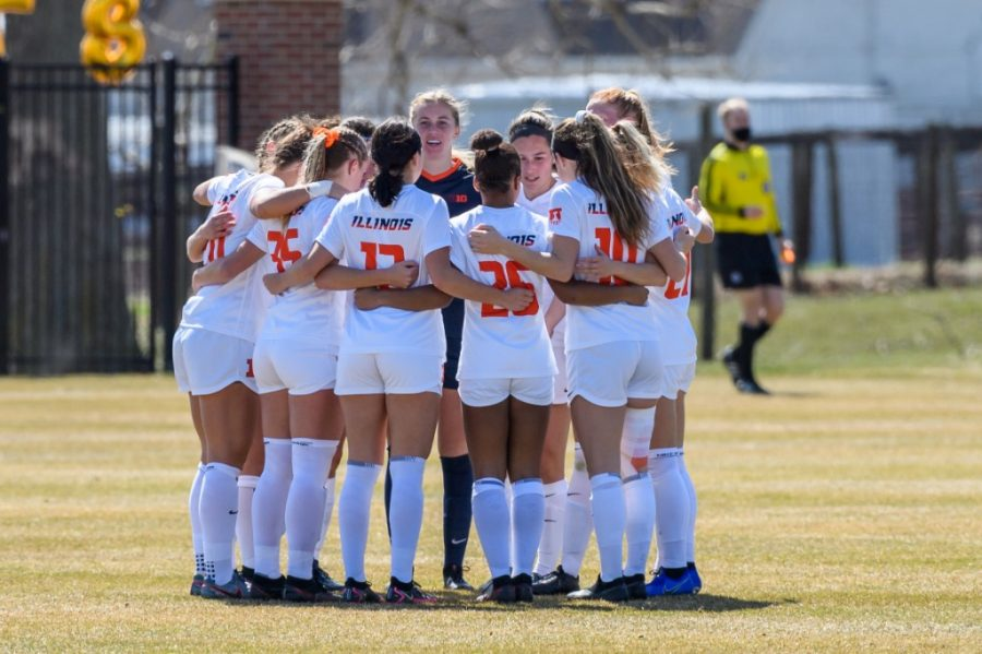 The Illinois soccer team huddles up during the game against Ohio State on March 21. The team won 4-0 against Mizzou on Thursday.