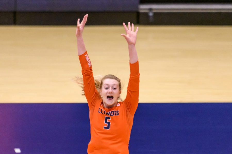 Diana Brown celebrates during the game against Maryland on March 20.  Illinois volleyball setters are set to make a big impact this season.