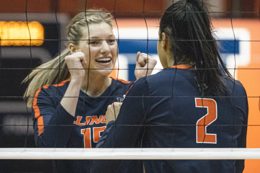 Senior Megan Cooney celebrates with Rylee Hinton during the game against Indiana March 27. Illinois volleyball will consist of star newcomers and well seasoned veterans for the upcoming season.