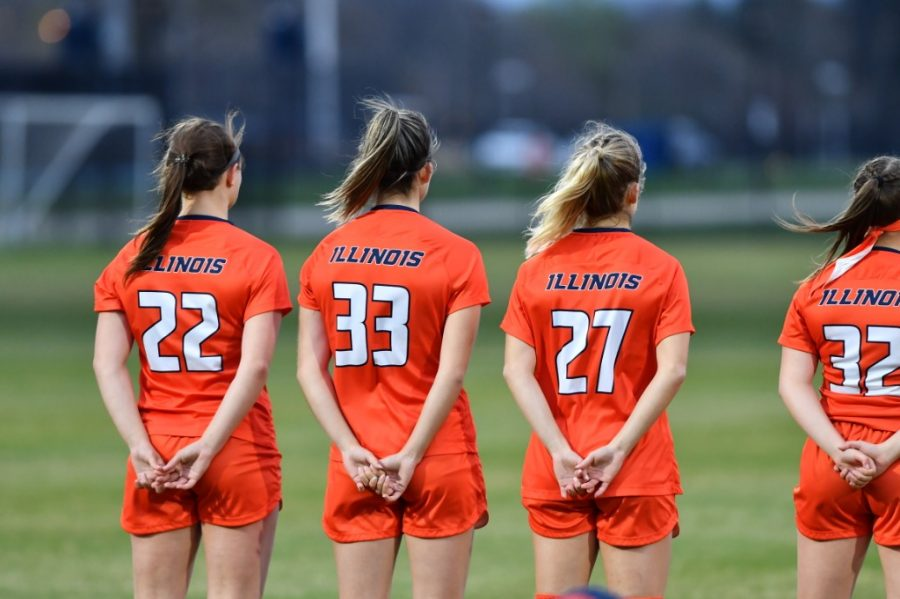Members of the Illinois soccer team line up with their hands behind their backs during the game against Iowa during the B1G Regional Weekend April 8. Illinois fell to Notre Dame today 0-4 at Demirjian Park.