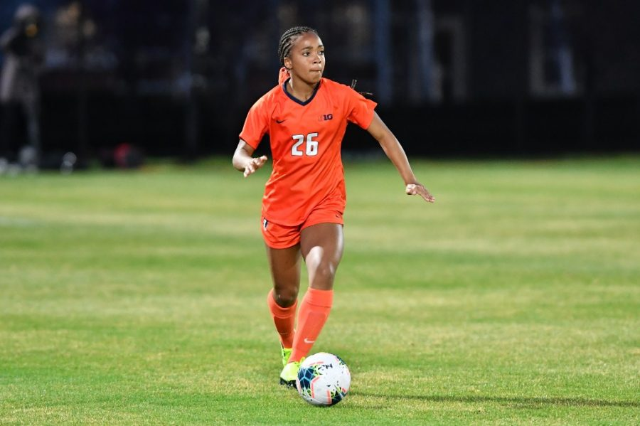 Illinois soccer player Summer Garrison looks to an open teammate to pass the ball to at the B1G Regional Weekend during a game against Iowa April 8. The team will travel to Mizzou to start off their regular season on Thursday,