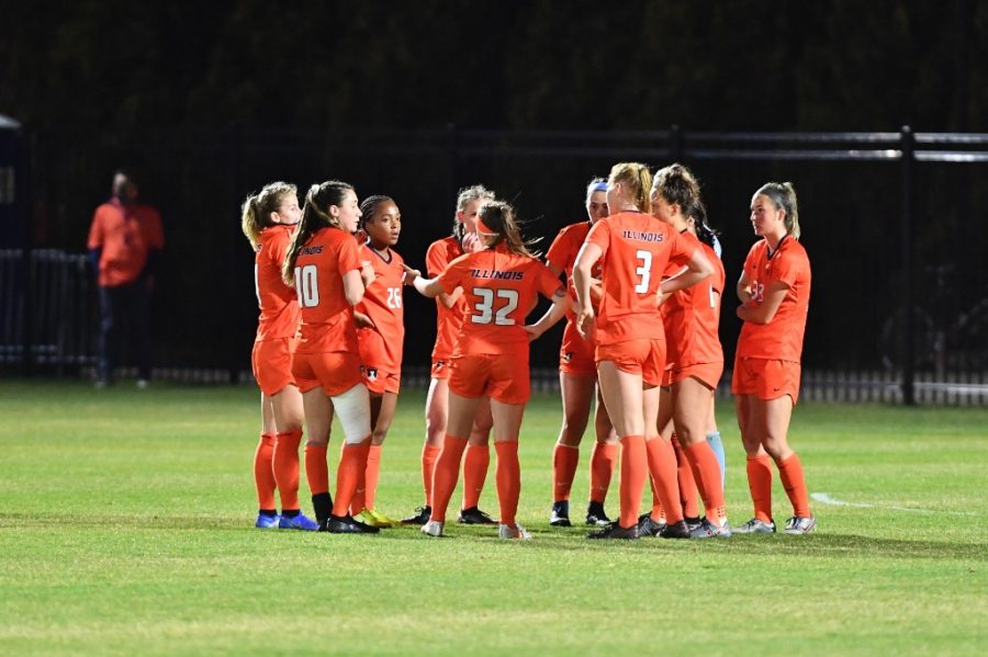 Players on the Illinois soccer team huddle during a game against Iowa at the B1G Regional Weekend on April 8. The Illini will finish off their preseason exhibition slate against Notre Dame.