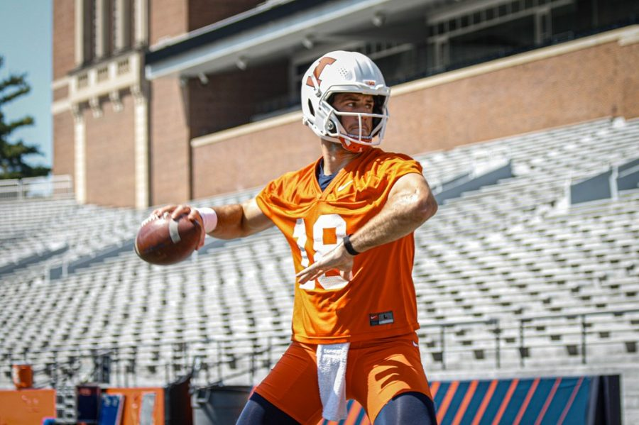 Quarterback Brandon Peters practices at training camp Aug. 6. Illinois football coach Bret Bielema keeps a retained roster for the upcoming season.