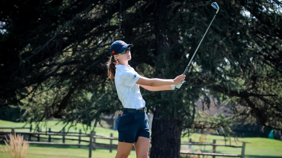 Freshman Lexanne Halama swings at a golf ball at the Wolverine Invitational. The team hopes to improve upon their game at the Schooner Fall Classic.