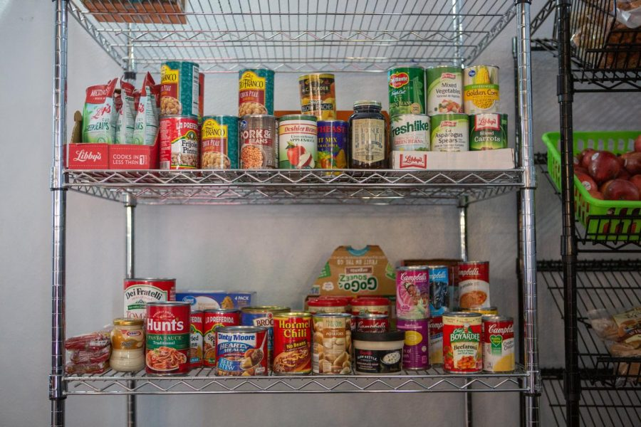 Canned food sits on a shelf at the Wesley Food Pantry on Feb. 21, 2020. Many University students are faced with food insecurity.