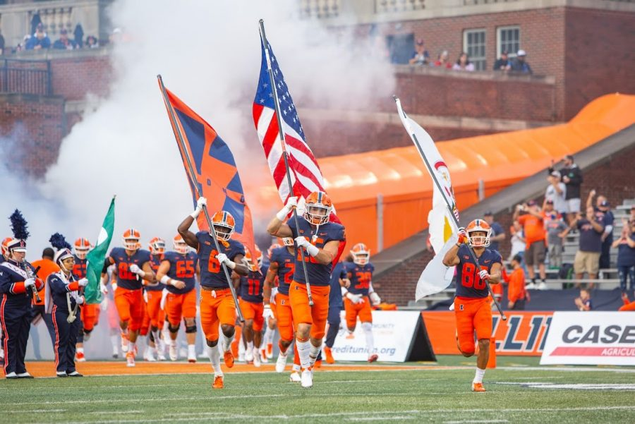 Illinois players run out of the tunnel before the teams game against the University of Texas at San Antonio on Sept. 4. The Illini look to get back in the win column against the Maryland Terrapins on Friday night.