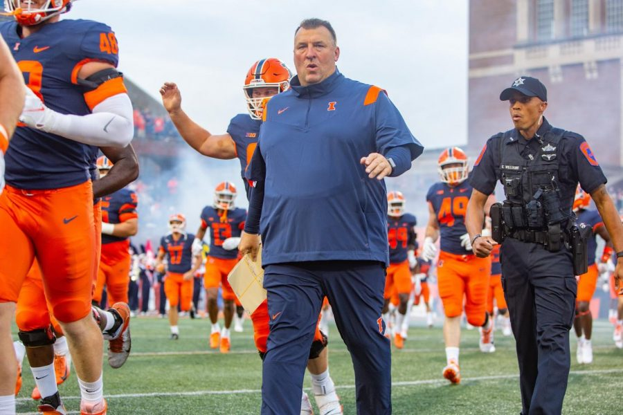 Bret Bielema walks onto the field during the footballs game against UTSA  on Sept. 4. Illinoiss football team works on getting into a groove to play with this season.