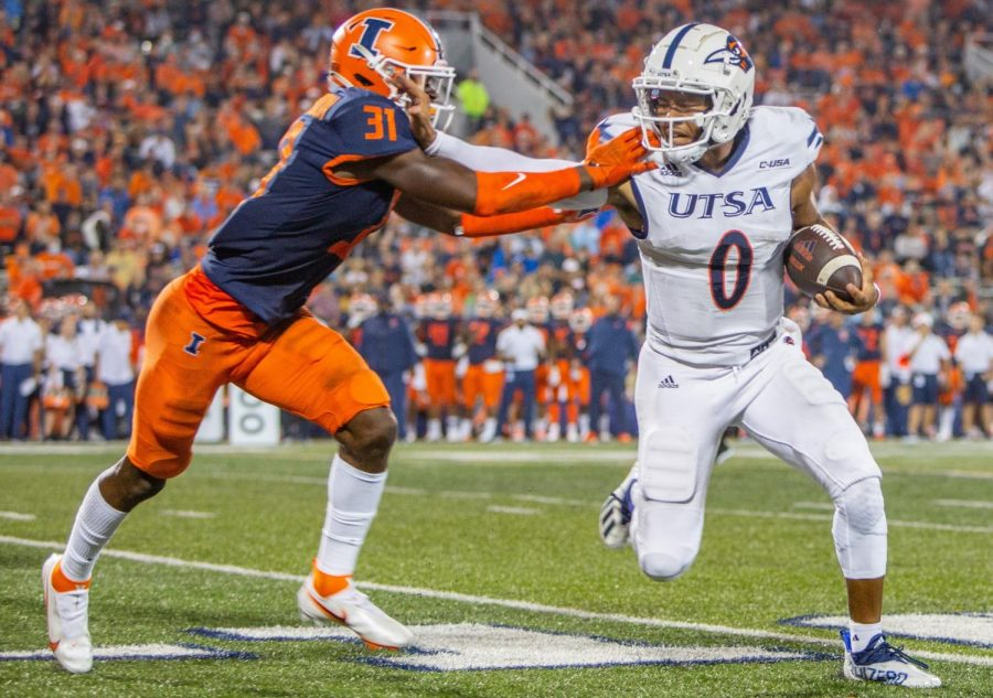 Devon Witherspoon attempts to push a UTSA receiver out of bounds during the game against the University of Texas at San Antonio on Sept. 4. Witherspoon and the Illini secondary struggled against a high-powered Virginia offense on Saturday.