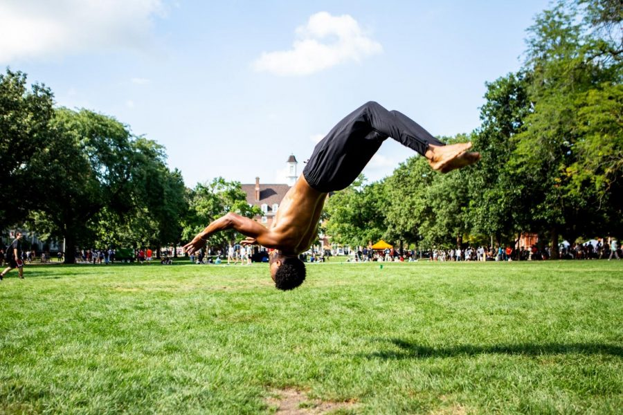 A student does a backflip on the Main Quad during Quad day. The Quad has many purposes whether it is preforming, or chilling, it is often exciting.