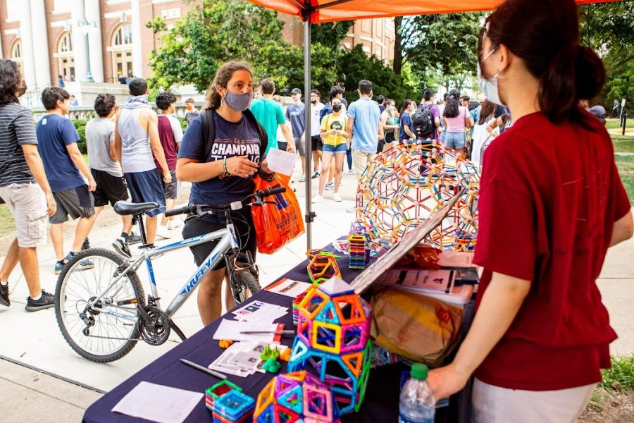 A student bikes to Quad Day on Aug 22. Bike to Work Day encourages biking to places instead of driving to them.