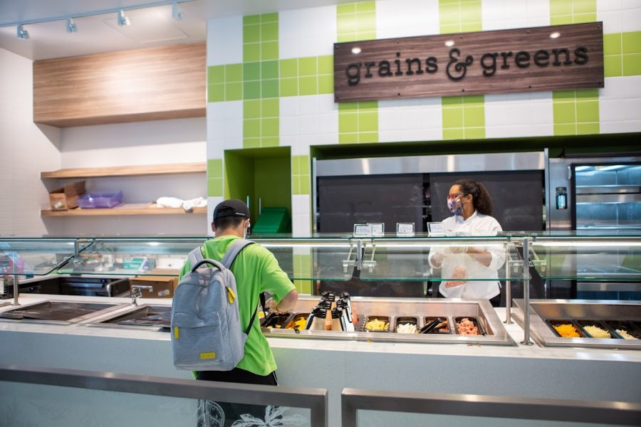 A students picks out what he wants to eat at Illinois Street Residences Grains & Greens station. Vegetarians living in the dorms found that seeing what each dining hall has been serving helps them find a healthy meal to fit their needs.