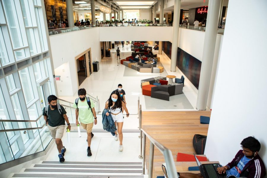University students walk up the stairs from beneath ISR's dining hall on Aug. 27. Upperclassmen react to the new renovations at ISR and compare old versus new design.