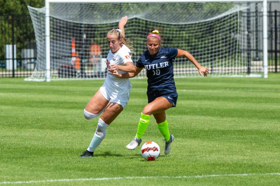 Forward Lauren Stibich attempts to steal the ball from her opponent during the game against Butler Aug. 29. The Illinois soccer team fell to Xavier University Thursday night 1-2.