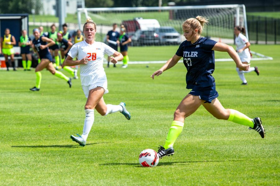 Midfielder Sydney Stephens runs along side her Butler opponent in an attempt to steal the ball during their game on Aug. 29. Stephens scored the winning goal in the Illinois soccer game against Toledo.