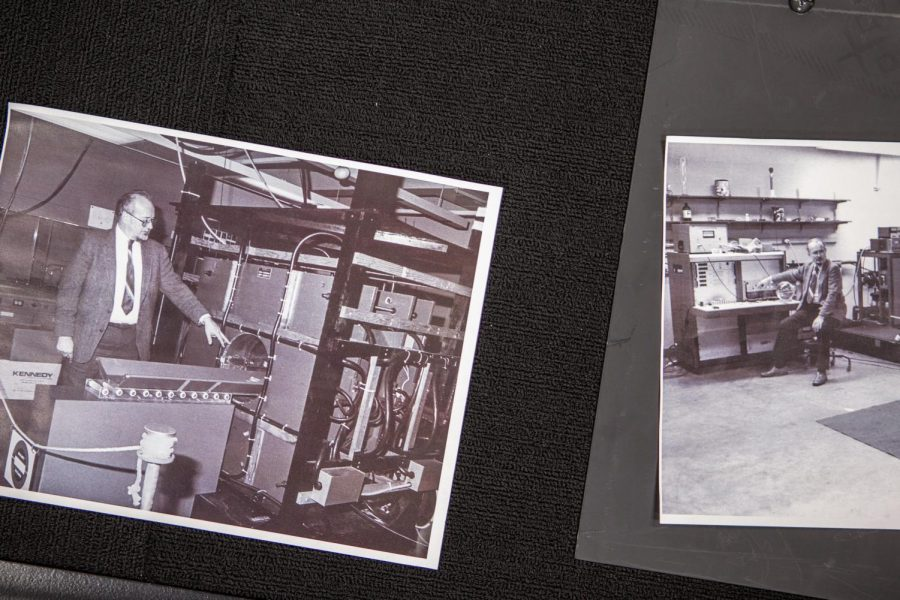 A photo in the MRI exhibit at Beckman Institute shows the late University faculty member Paul Lauterbur next to his invention, the MRI machine.