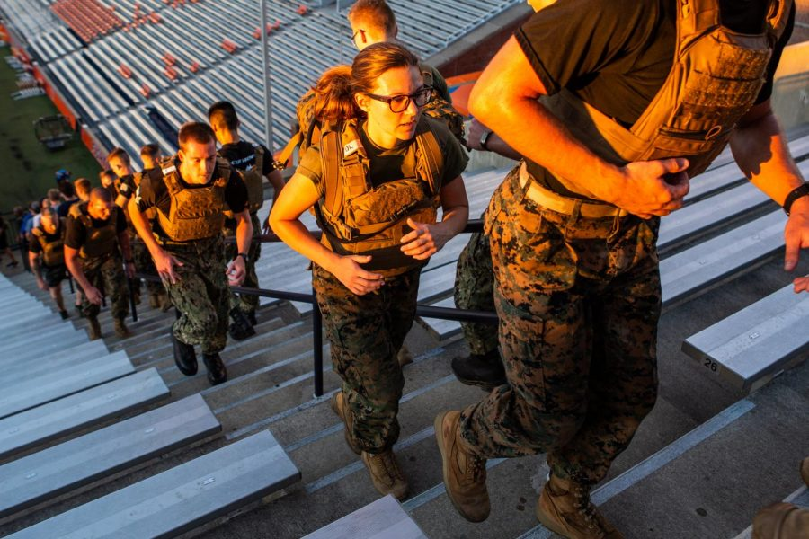 Members of the ROTC Marine Corps program climb the steps of Memorial Stadium on Sept. 9 to honor first responders in 9/11.