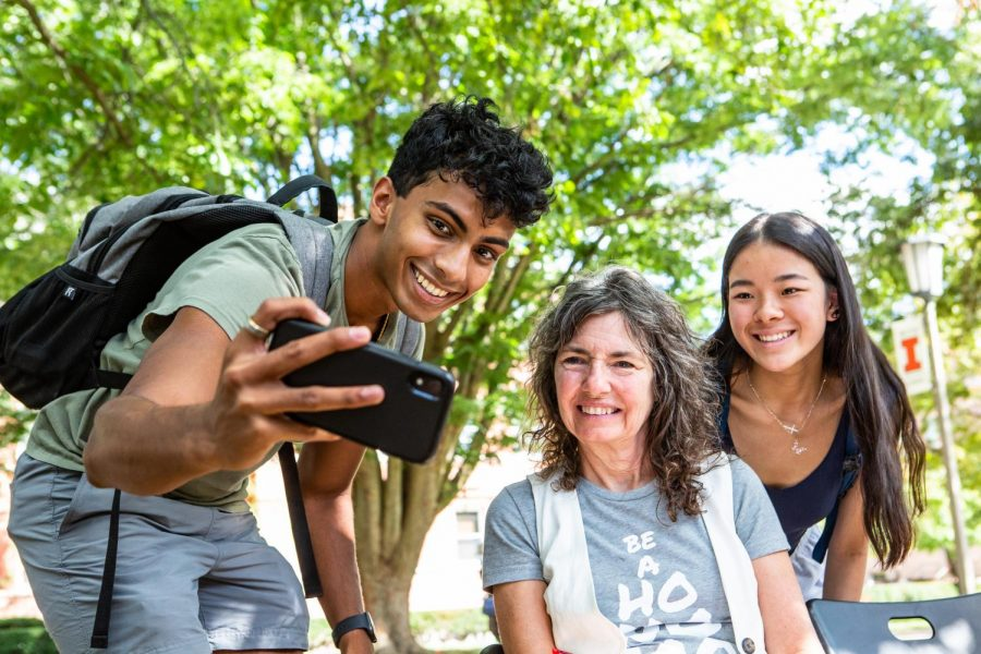 Sister Cindy poses for a photo with two Illinois students on the Main Quad on Sept. 8. Multiple preachers have been traveling to college campuses across the country to share their beliefs.