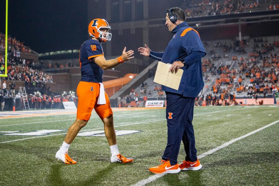 Coach Bret Bielema and quarterback Brandon Peters high five before the game against Maryland on Sept. 18. Illini football needs to make some changes to improve during the rest of their season.