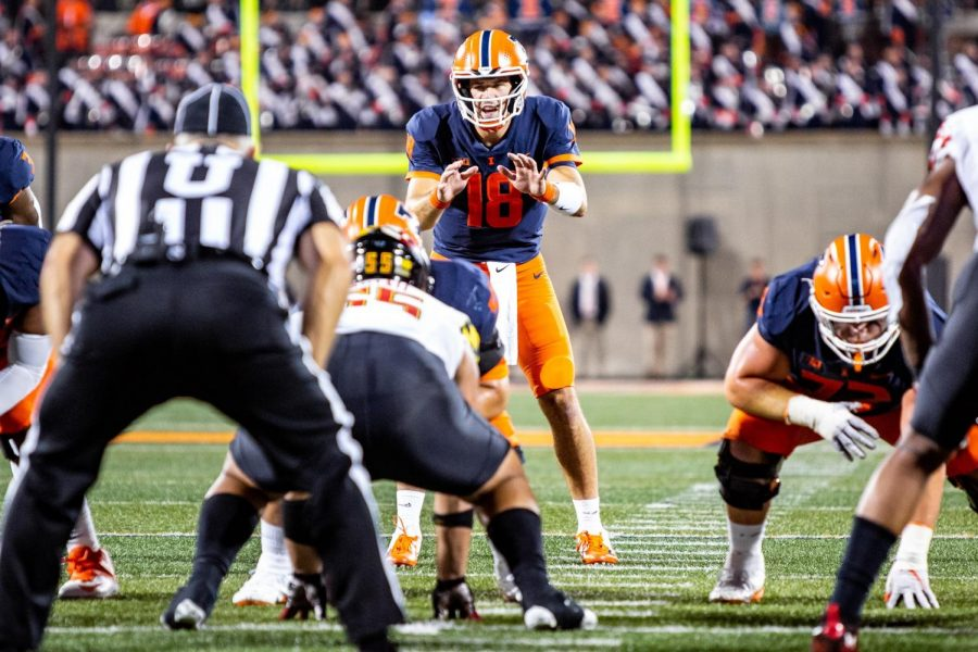 Quarterback Brandon Peters prepares to receive the snap during the game against Maryland on Friday. After missing two games due to an injury, Peters returned on Friday, though an underwhelming performance drew concerns about the Illinis  quarterback situation.
