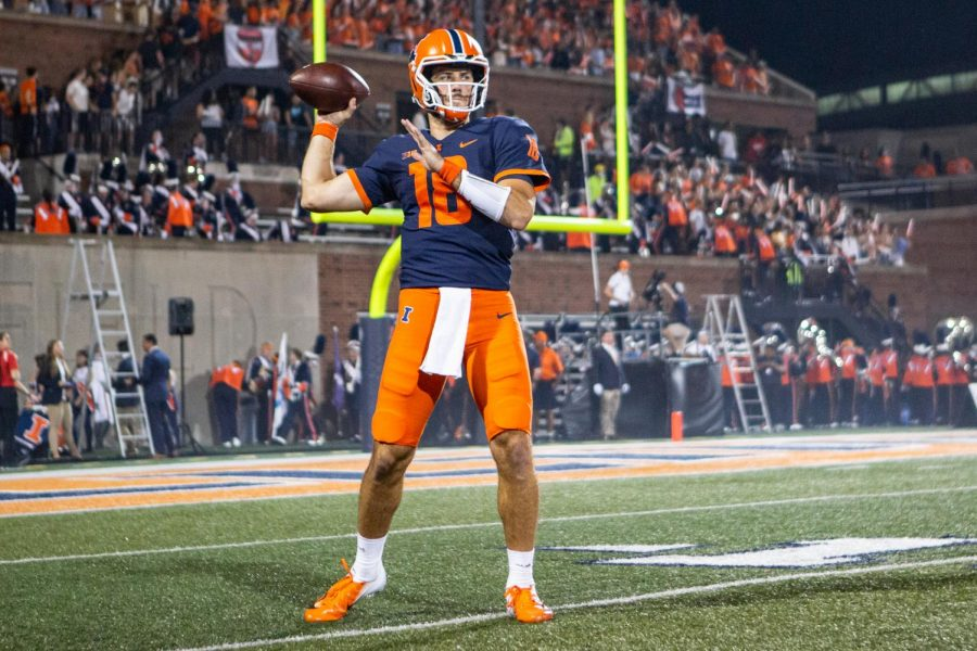 Quarterback Brandon Peters warms up before the game against Maryland Sept. 17. Illinois football travels to Purdue in search of a first road win of season.