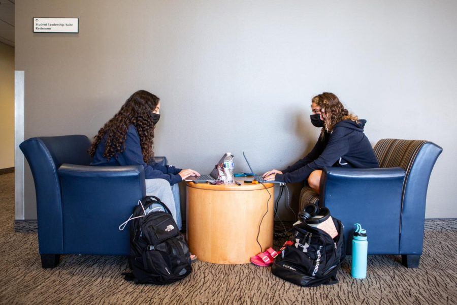 Nora Rafaty and Hulya Goodwin, students in LAS, study in the upstairs lounge of Ikenberry Commons on Sept. 18 while wearing masks. COVID-19 cases have decreased in the last week.