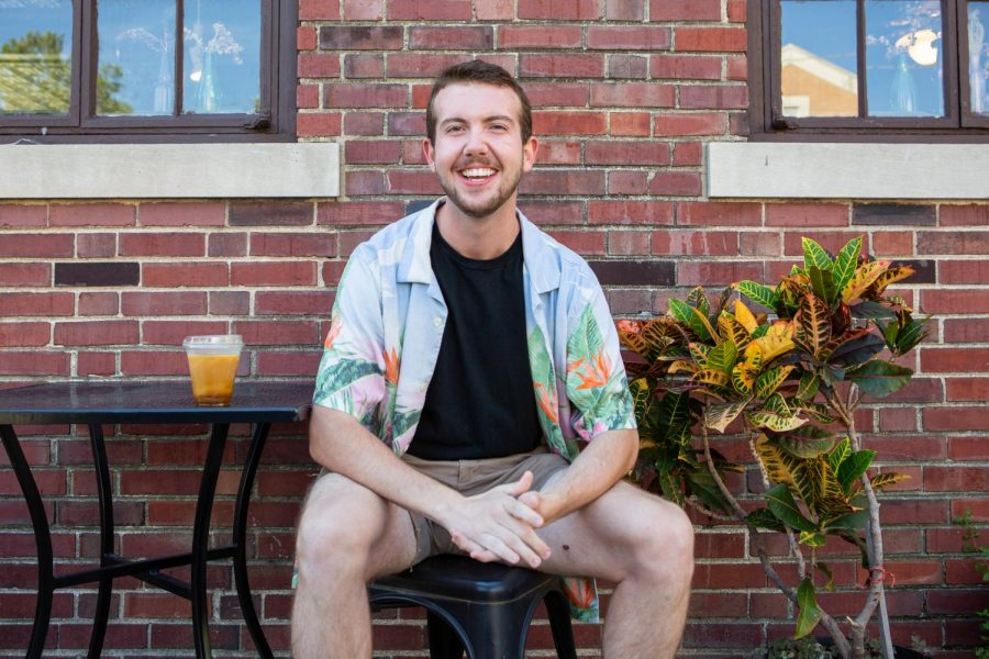 Dylan Beasley, Senior in LAS, poses for a photo at Cafe Paradiso on Sunday morning where he usually contemplates what he wants to do with his life.