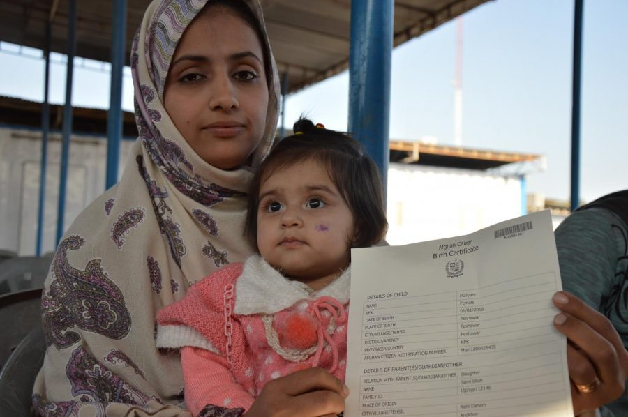 Neelab holds up her one year olds birth certificate. Columnist Eddie Ryan shares his opinion on the Afghanistan Refugee problem that is now taking place after the United States left Afghanistan.