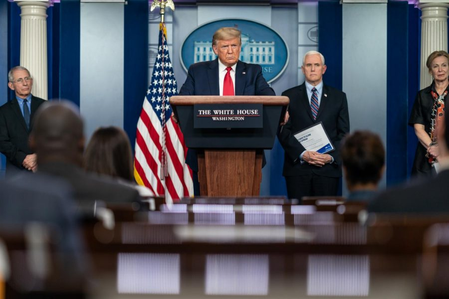 President Donald J. Trump, joined by Vice President Mike Pence and members of the White House Coronavirus Task Force, listens to a reporter's question at a coronavirus (COVID-19) update briefing on Thursday, March 26, 2020. Columnist Dennis Austin argues that Donald Trumps demise is partly due to how he handled last summers events with COVID-19 and racial injustice.