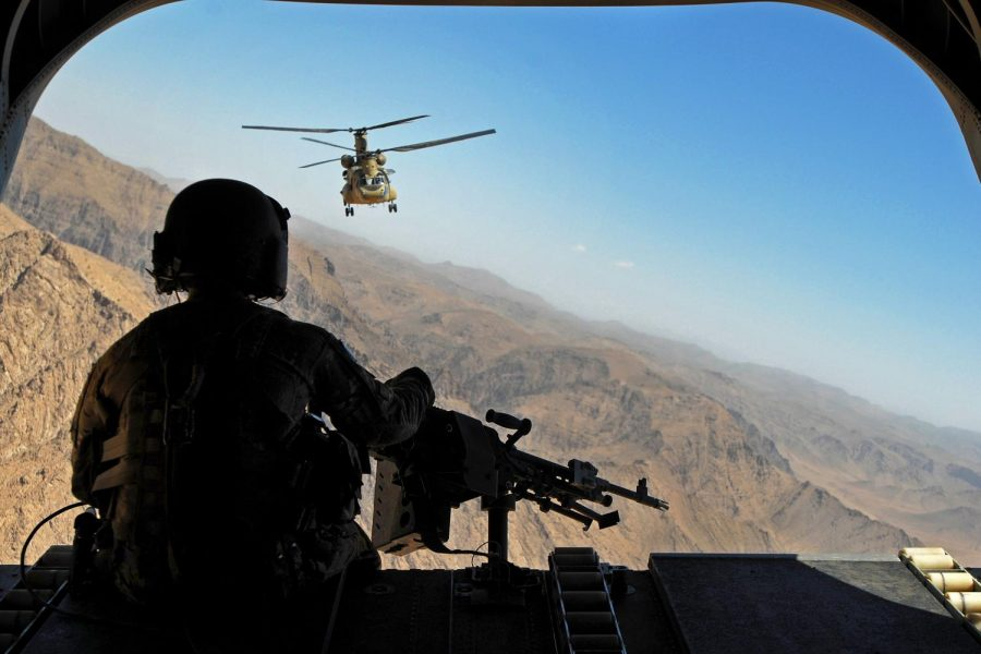 Sergeant Zach Smola, rear door gunner on a CH-47, keeps watch on the mountains in Uruzgan province, Afghanistan on May 12, 2013. Columnist Eddie Ryan argues that Americas self absorption has hurt Afghans yet again.