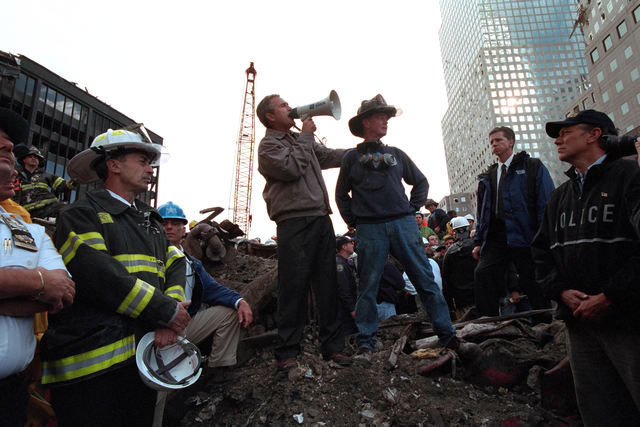 Standing atop rubble with retired New York City firefighter Bob Beckwith Friday, Sept. 14, 2001, President George W. Bush rallies firefighters and rescue workers during an impromptu speech at the site of the collapsed World Trade Center in New York City. Columnist Dennis Austin argues that America is void of its post 9/11 unity.